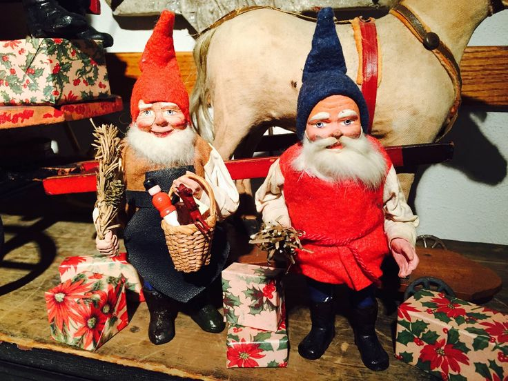 """Antique Scandinavian Gnomes / Tomtes / Nisse with vintage """"poinsettia"""" christmas gift boxes."""