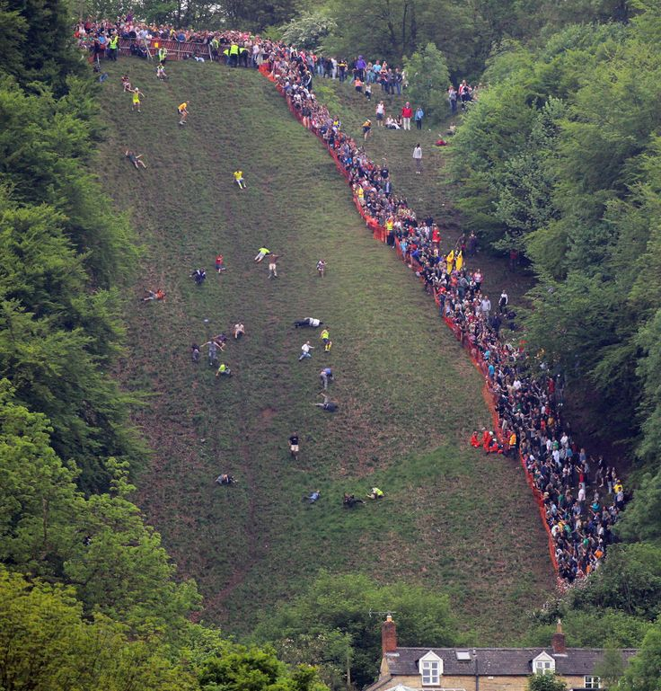 Cheese rolling on Cooper's Hill In Gloucestershire. I HIGHLY recommend going to YouTube and watching videos of this event, as it is incredibly entertaining. Needless to say, I will partake in these activities at some point in my life.