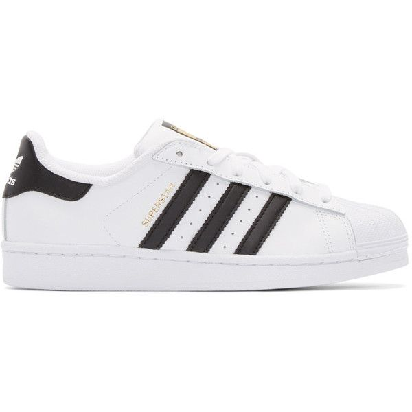 adidas Originals White and Black Superstar Sneakers ($77) ❤ liked on Polyvore featuring shoes, sneakers, adidas, sapatos, white, low top, black white sneakers, leather lace up shoes, low profile sneakers and perforated leather sneakers