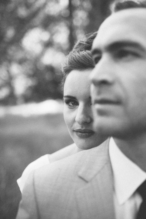 cute couples shot - peeking over his shoulder