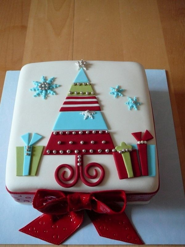 Wonderful looking Christmas themed cake. The cake has a Christmas tree design on top surrounded by presents and snowflakes in cartoon version which makes the cake look adorable.