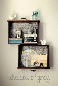 Old dresser drawers re-purposed as shadow box-ish shelves.