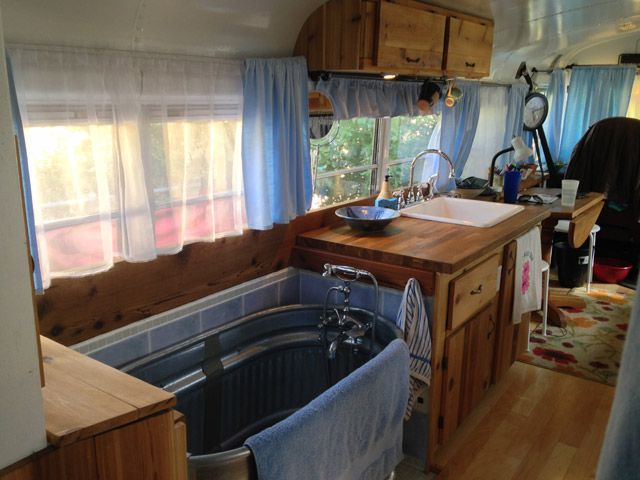 """Paying rent felt like a waste of money and buying a home was a financial and time commitment we couldn't afford. Our bus gives us a leg up on saving for the future and paying off our considerably large school debt"" - just got an idea of covering up the bath to make another bench or seating, therefore having a multifunction for this tub ~ clikc photo for more ~"