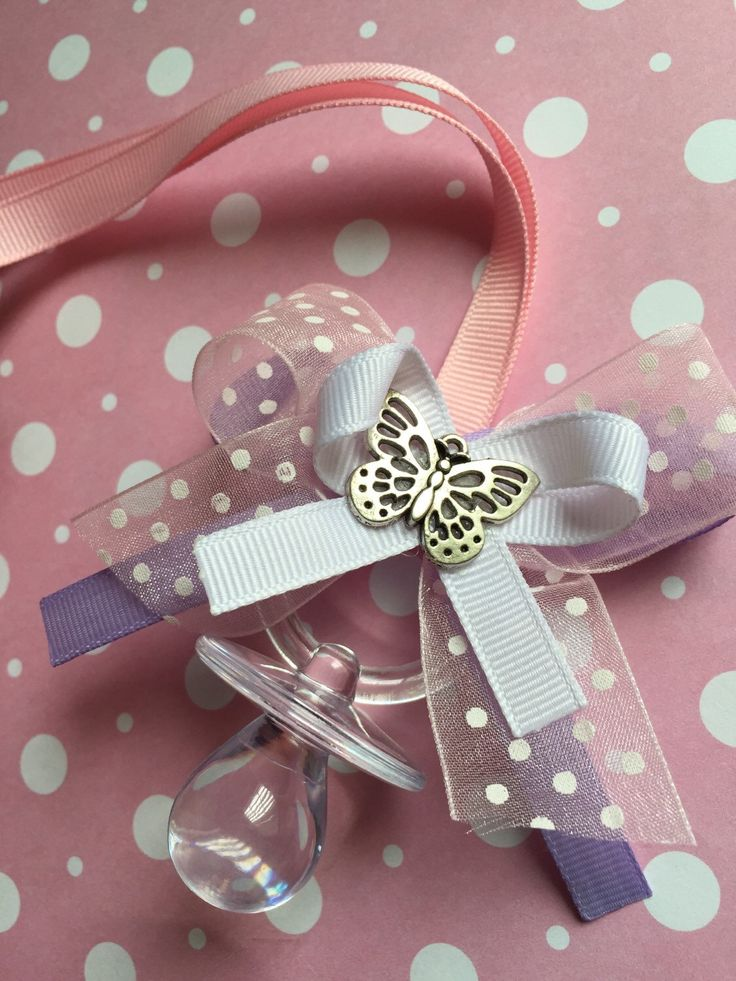 Pink and purple baby shower. Butterfly baby shower theme. Princess theme shower. A personal favorite from my Etsy shop https://www.etsy.com/listing/225728226/pink-and-purple-baby-shower-pacifier