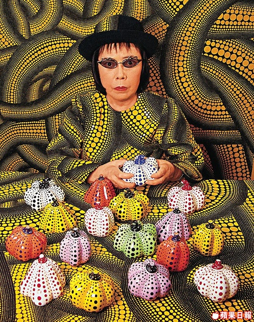 Yayoi Kusama with little dotted pumpkins