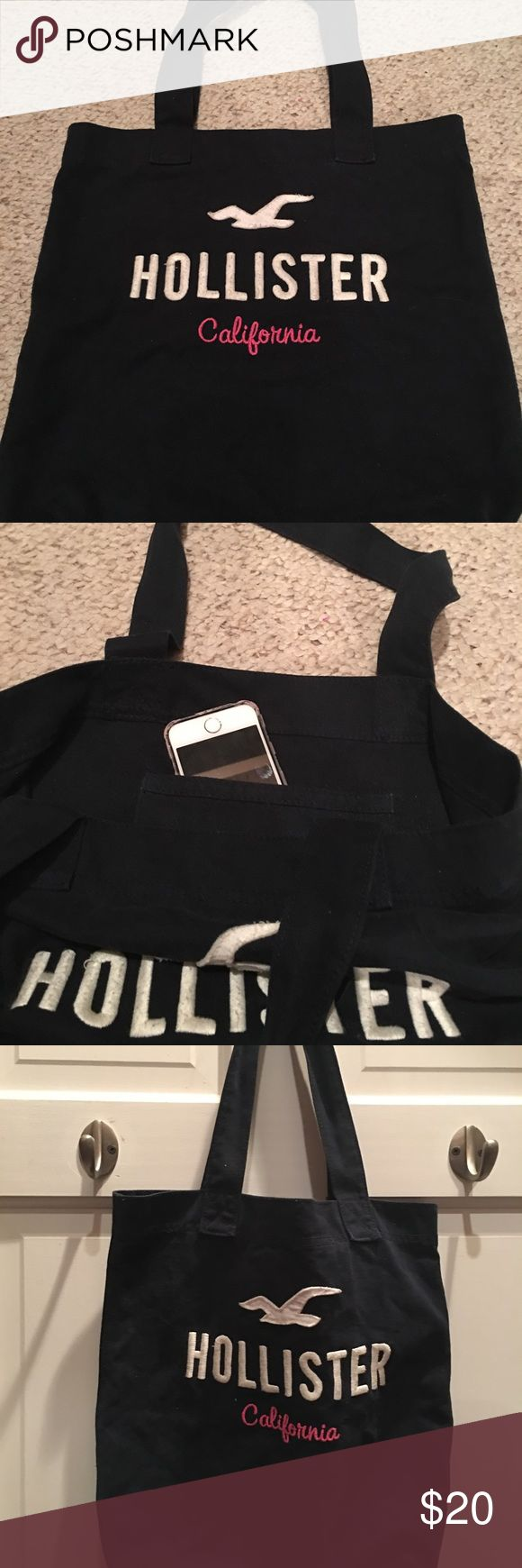 NWOT Hollister tote bag Hollister Tote bag. Small pocket on the inside, perfect for a cell phone! Navy blue with white and pink lettering. Excellent condition!!!!! Hollister Bags Totes