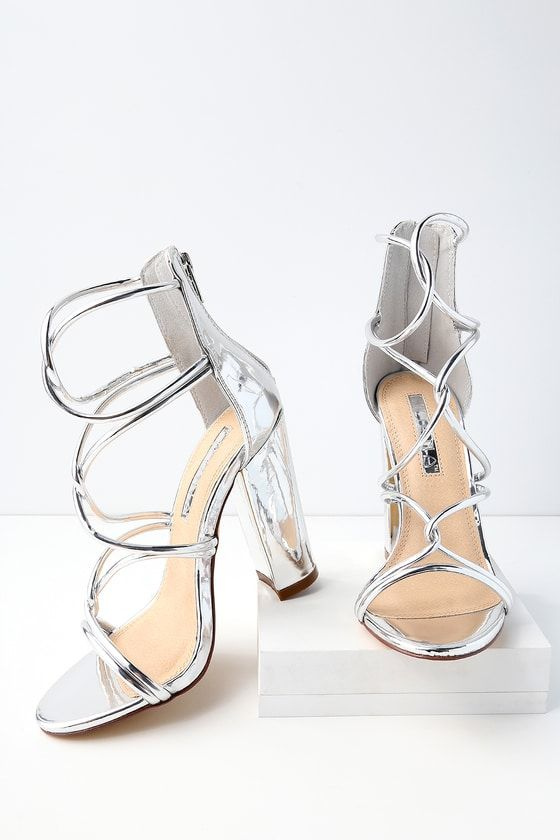 ccefeb863 Show off your pedi in the Beau Silver Patent Dress Sandals! Glossy vegan  leather shines over a peep-toe upper with rounded straps that continue all  the way ...