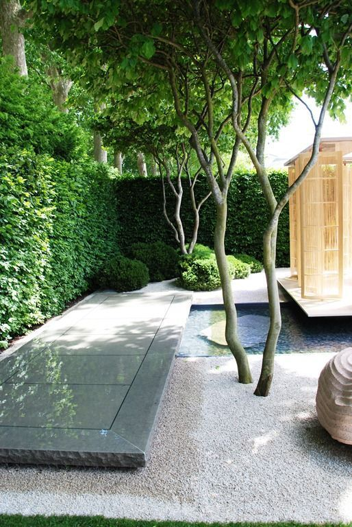 """ Stunning small space garden where zen and modern meet. High quality craftsmanship. Garden design Luciano Giubbilei, architect Kengo Kuma, and sculptor Peter Randall-Page. """