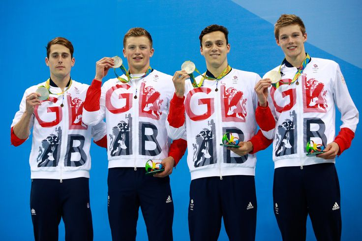 Silver medalists Chris Walker-Hebborn, Adam Peaty, James Guy and Duncan Scott of Great Britain pose on the podium during the medal ceremony for the Men's 4 x 100m Medley Relay Final on Day 8 of the Rio 2016 Olympic Games at the Olympic Aquatics Stadium on August 13, 2016 in Rio de Janeiro, Brazil.