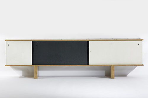 Works by Charlotte Perriand and Jean Prouvé are in demand. This storage unit designed by Charlotte Perriand was commissioned by Mr. and Mrs. Cor through Galerie Steph Simon to accompany the Nuage Bibliothèque. Three sliding doors conceal storage compartment and two adjustable shelves.  Bloc bahut, 1959, by Charlotte Perriand, Ateliers Jean Prouvé for Galerie Steph Simon,  Sold at Auction for $240,000