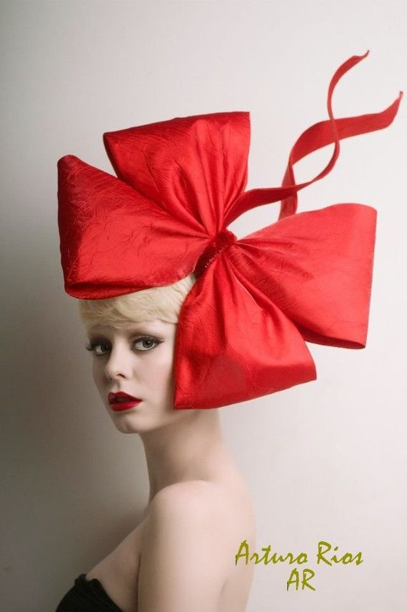 Fascinator | Couture red bow fascinator, $340 via Arturo Rios