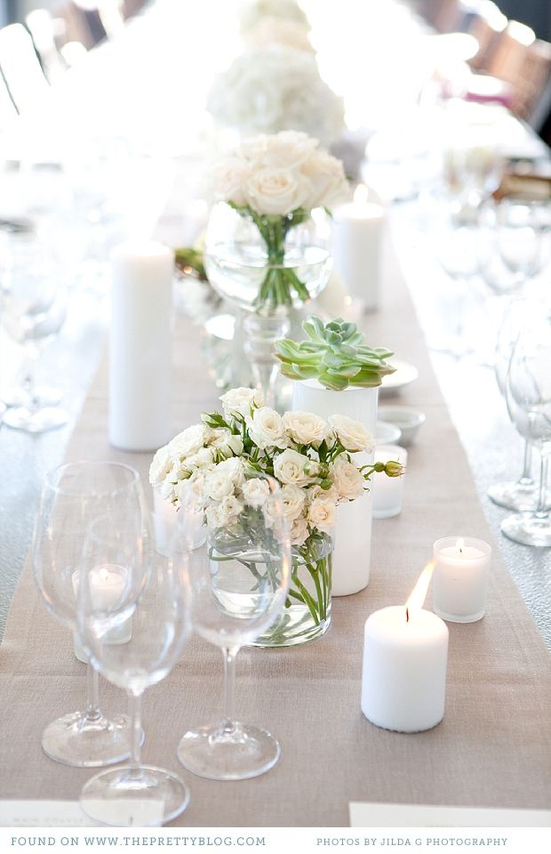 White table flowers in clear vases. Simple but elegant. | Photo: Jilda G Photography