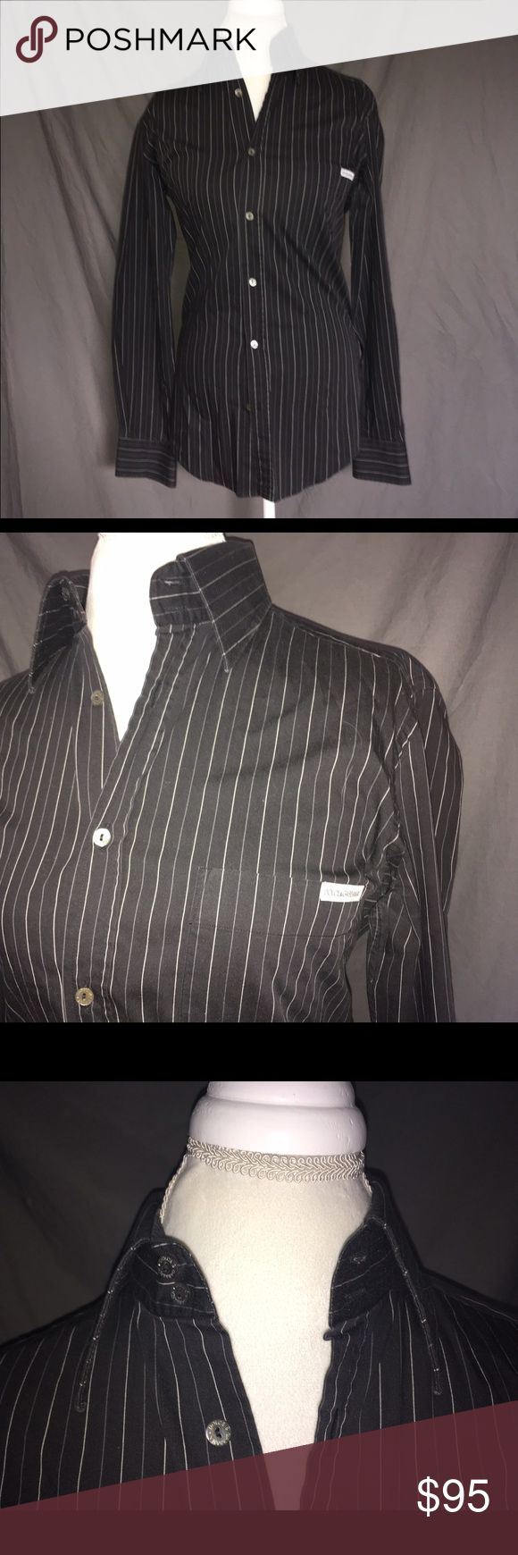 Dolce & Gabbana Button Down Black Dolce & Gabbana button down shirt. The Dolce & Gabbana logo is on the left side of the chest and the buttons. This is a mans shirt but my mannequin is a size 10 and fits beautifully. What a great piece to add to your collection!! Made in Italy. Dolce & Gabbana Shirts Dress Shirts