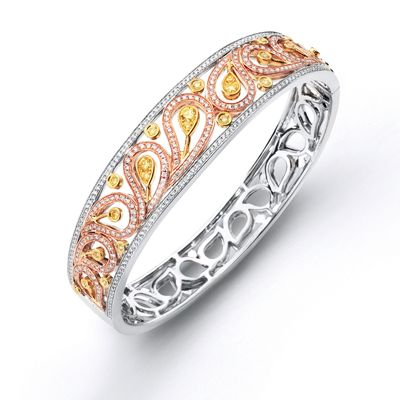 This exquisite 18K white, yellow and pink bangle is comprised of 1.56ctw round white Diamonds, .25ctw round yellow Diamonds, and a .72ctw pear shaped yellow Diamond.    MB1426-A