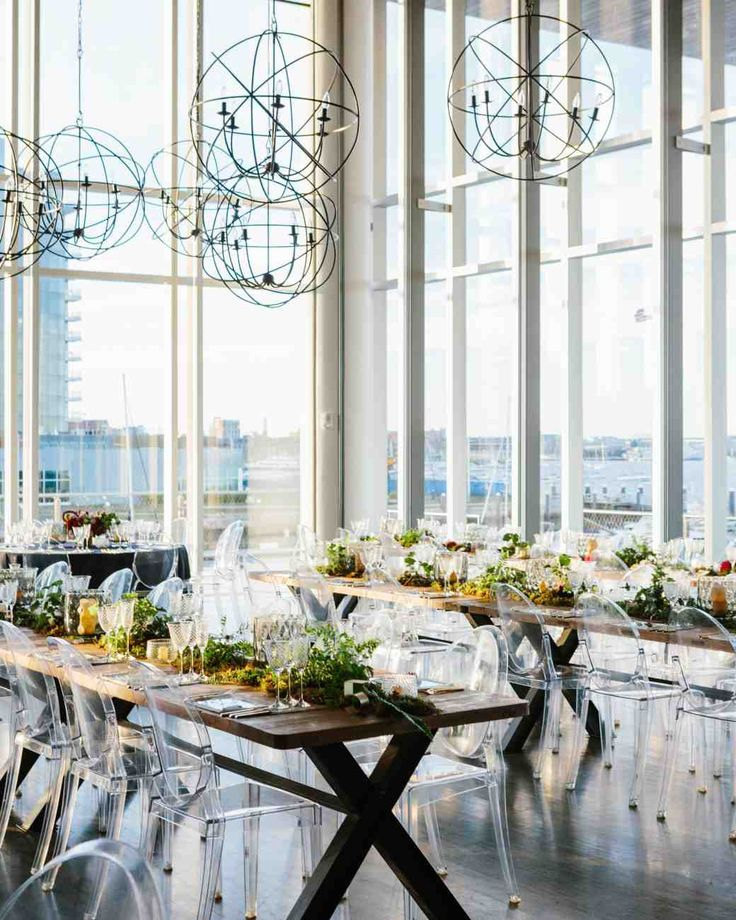 A Contemporary Wedding at a Boston Art Museum | Martha Stewart Weddings - Held in ICA's theatre, the reception space had walls of windows with views of the Boston Harbor. Ghost chairs added a contemporary touch to the traditional wooden farm tables, while the wire chandeliers that hung from above flowed seamlessly with the avant-garde aesthetic of the museum.