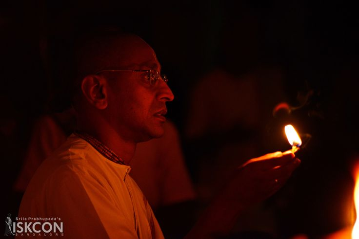offering Diya at the Lord's feet