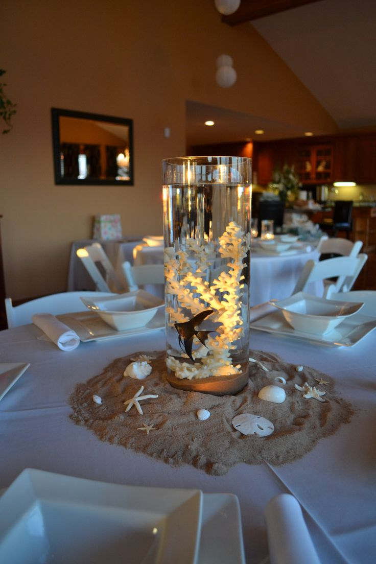 Centerpieces for beach themed baby shower with real fish for Baby blue wedding decoration ideas