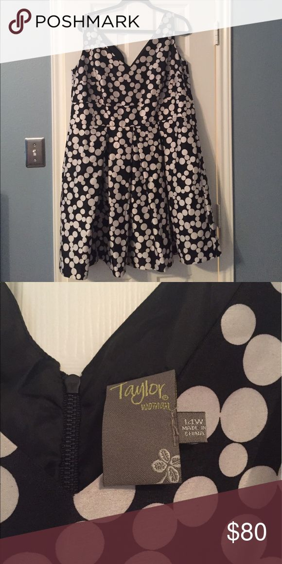 Black and Ivory Polka Dot Dress for Work or Play This is a used (but in excellent condition) black and ivory polka dot style dress. Great for work, wedding guest, date night, etc. I work it only a couple of times to work conferences. Taylor Dresses
