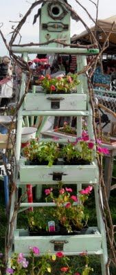 love, love, love this!! old ladder, some drawers, birdhouse all painted same color with some grapevine ~ might even be useful in the house with potted plants or in the sewing corner