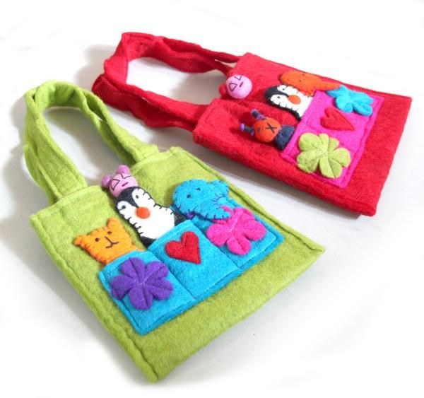 These fun felt finger puppet bags are made to hold your little ones' precious things. Fair trade felt baby and kids gift. Made in Nepal.