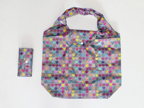 foldable reusable bag... folds into a mini wallet pouch!