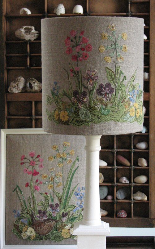 Botanical lampshade made using over 200 tiny pieces of fabric and free-motion machine embroidery.