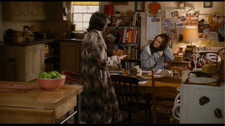 """The Family Stone -- this desk area gives us a huge insight into Sybil's character.  The layers of papers, clippings, and artwork made years ago by one of her children.  In one shot of this area, we immediately understand that Sybil is easy going, not fussy, doesn't need anything in her life to be in perfect order and likes to always be at the home's """"heart"""" center, the kitchen, with the dining table acting as desk and eating area. I love the world they created for this family."""