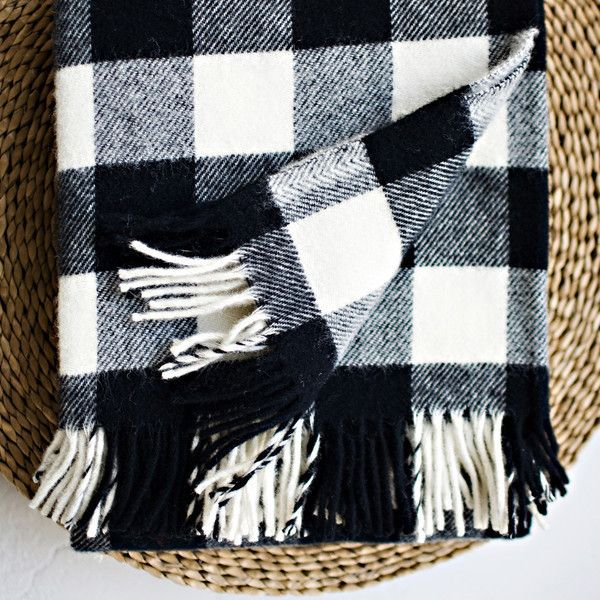 """Based on the timeless buffalo check design, this pattern is Faribault classic that we've made for more than a century. Crafted from pure lambs wool with a fringed edge. - Dimensions: 50"""" x 60"""" - 100%"""