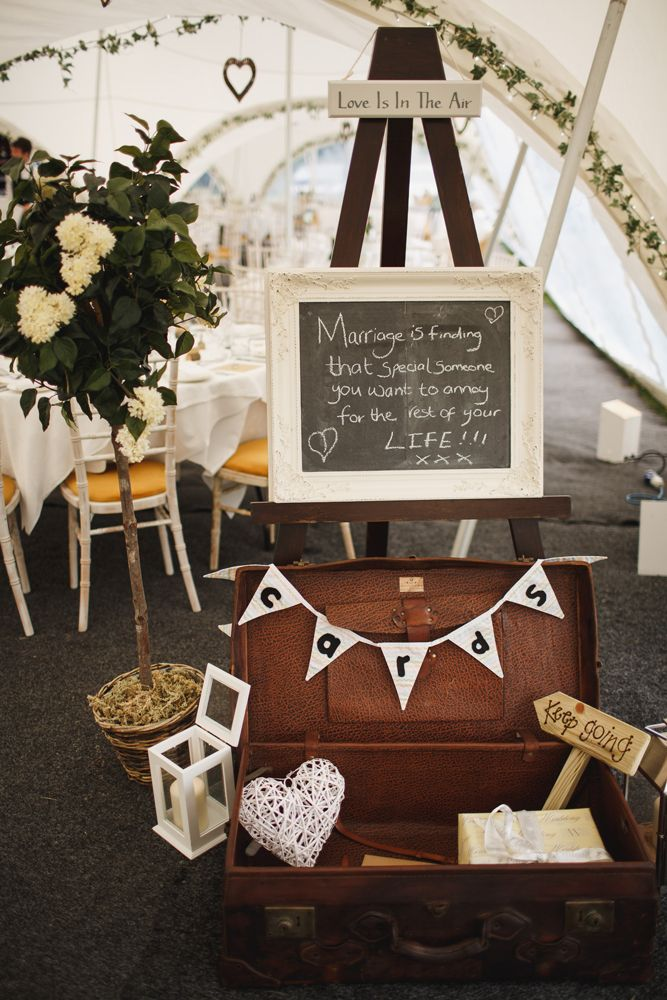 A cutesy vintage suitcase accompanied with a chalk board sign for gifts and cards for the bride and groom | Present table ideas | For more inspiration visit www.weddingsite.co.uk