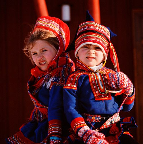 Sami boy and girl in traditional clothing. Kautokeino. Norway.