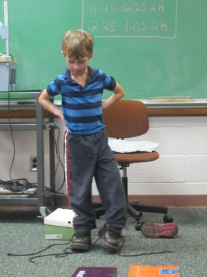 """Lesson on empathy - students volunteer to choose a shoebox to open and put the shoes on from the box.  A written scenario inside each box tells about the person who wears the shoes. Based on the information given, the student has to """"put themselves in that person's shoes,"""" identifying how that person might feel.   The class then suggests ways we might show compassion to the person in the shoes."""