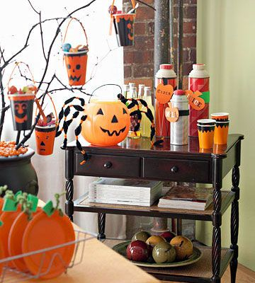 Ghoulish Drink Station like the use of the pumpkin for an ice bucket!!