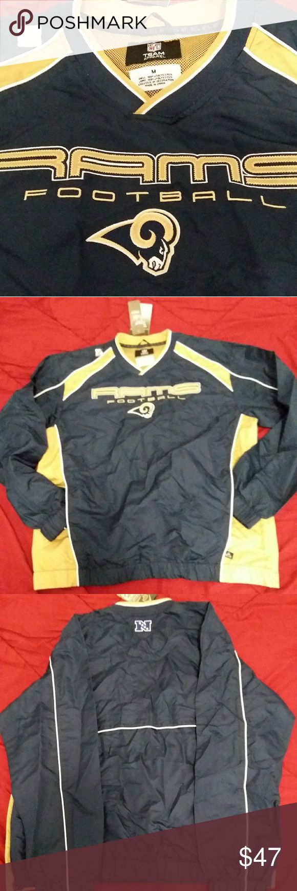 🏈Mens NFL L.A. Los Angeles RAMS Football Pullover Official NFL Team Apparel 2 sides pockets with zipper downside along the side of the v neck  pullover. This is e-systems performance enhanced breathable fabric designed to provide severe weather protection,  rain resistenance. Comes from smoke and pet free environment   Thank you NFL Jackets & Coats Performance Jackets
