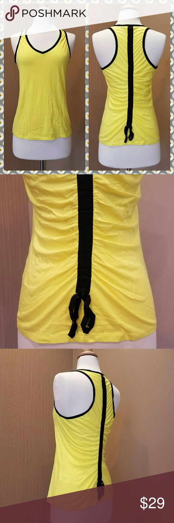 NWOT athletic top Brand new, never worn, PH8 top. It is BEBE SPORT'S upscale, luxurious line of athletic wear. Beautiful yellow with black piping, ruched back with adjustable strings running down the middle. You are going to make a slash! I took the tags off, as I do most of the time, but never got to wearing it. Too many tops, too lazy when it comes to workouts:) ph8 Tops