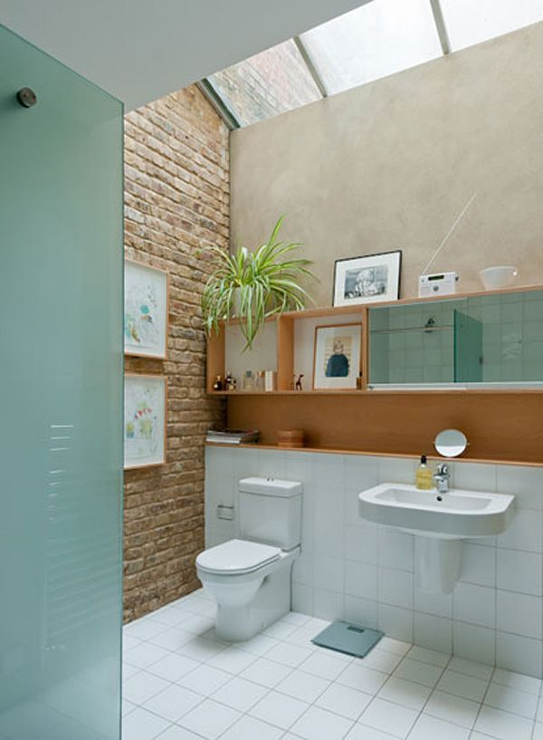 bright, clean white bathroom with good natural light and natural wood accents. love the brick wall.