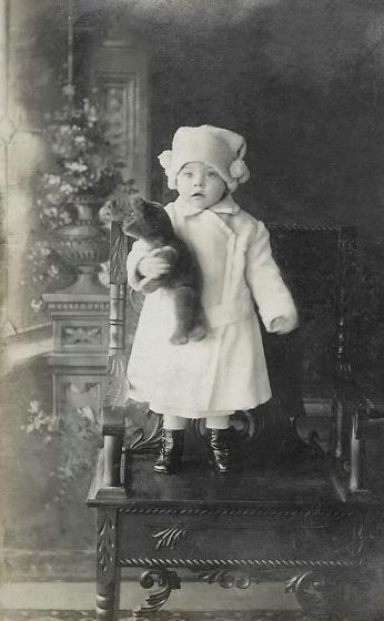 +~+~ Antique Photograph ~+~+  Toddler and her teddy bear all dressed up for the cold weather.