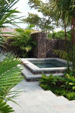 Tropical Hot Tub with exterior concrete tile floors, exterior tile floors, Fence, Pool with hot tub
