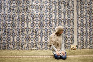 Muslim American woman Emily Miry, 24, takes part in an afternoon prayer at the Islamic Cultural Centere in Manhattan, New York