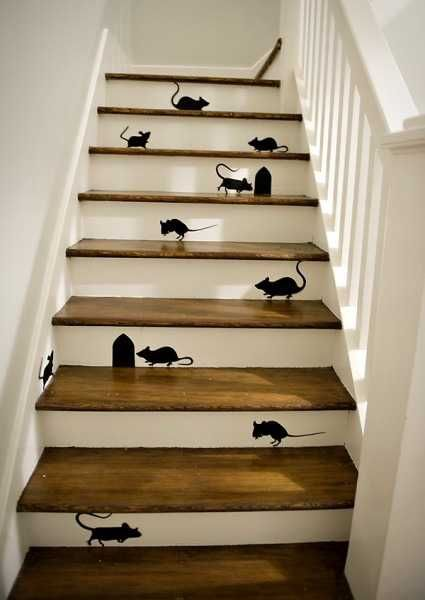 black mice and mouse holes painting on wooden stairs
