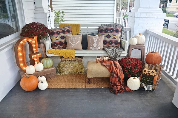 Make your porch bench or swing the ideal spot for relaxing in the crisp fall weather by adding cozy pillows and blankets. Pumpkins, flowers, and vintage finds add the perfect finishing touches.   See more at Liz Marie Blog.