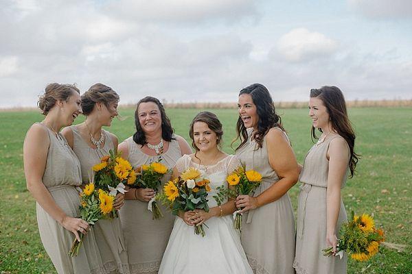 Taupe bridesmaids dresses with sunflower bouquets    #wedding #weddings #weddingideas #aislesociety #realwedding #rusticwedding