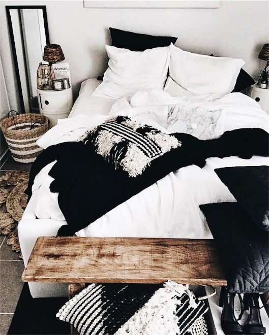 Inspired by this black and white bedroom with wood accents