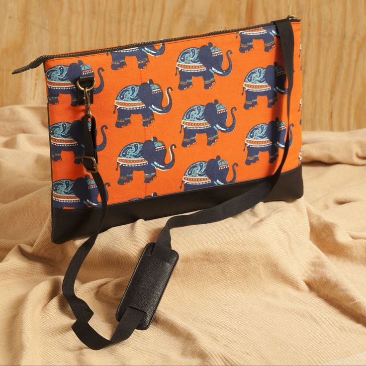 Elephant Block Genuine Laptop Bag Online. https://www.qtrove.com/products/elephant-print-laptop-bag Fits up to 15-inch laptop and has 4 compartments.This slim bag will make you fall in love with it. https://www.qtrove.com/products/elephant-print-laptop-bag