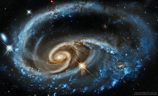 What's happening to this spiral galaxy? Although details remain uncertain, it surely has to do with an ongoing battle with its smaller galactic neighbor... - Divyajyoti Sahoo - Google+