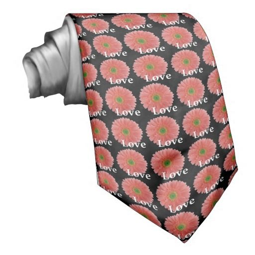 Unique, men's tie features a repeating pattern of peachy coral gerbera daisies on a black background with the word Love. This custom tie is perfect for weddings, engagement parties, anniversaries, vow renewals, etc. Order for the groom, groomsmen, ushers, and fathers of the bride and groom for a fully coordinated wedding party. This same pattern also available in coordinating postage stamps, invitation seals, favor stickers, etc. #coral #peach #love #black #green #gerbera #gerber #daisy #tie