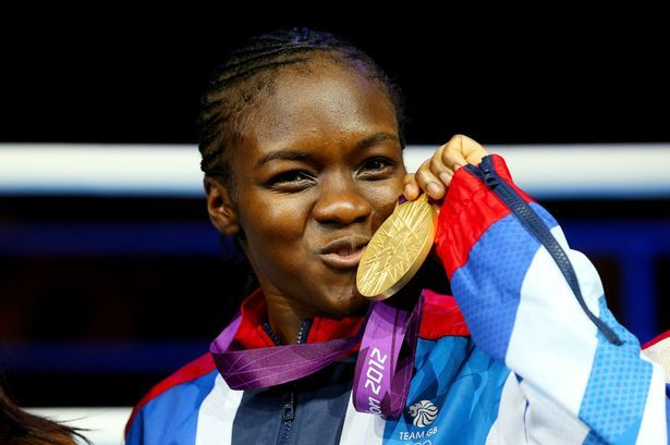 Nicola Adams celebrates after winning gold for Great Britain - First woman to win a medal in Boxing!