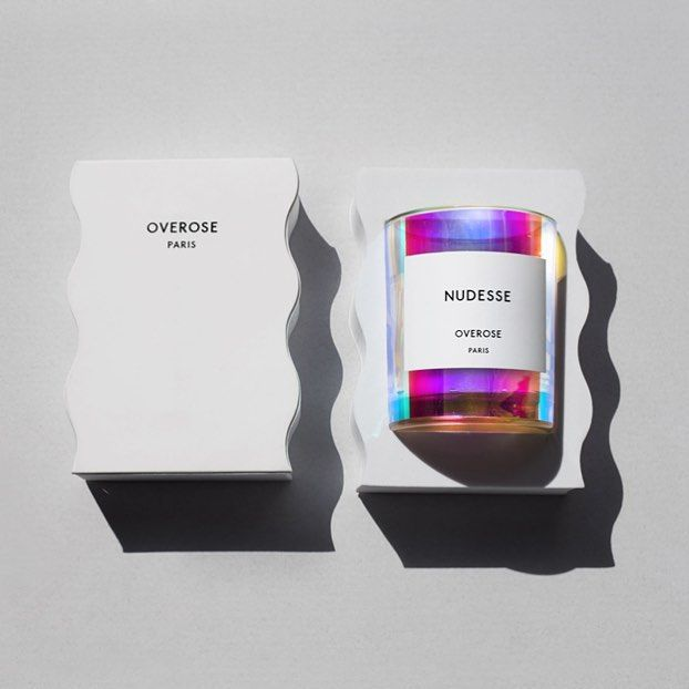 Overose Nudesse features a unique Rose and a favorite of ours : The Sterling Rose which is pale purple in color. The smell of the flower is highly fragrant with a rich sweet creamy honeyed aroma, encapsulated in Nudesse with the smell of rain. All Holo candles are back in stock.
