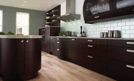 Dark Brown Cabinets With Gray Countertop And Subway Tile