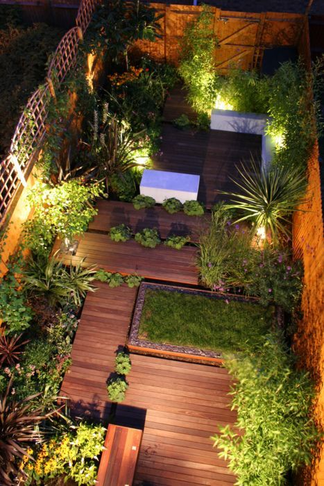 no grass back yard... sloped level, gorgeous decking and raised beds. THIS is what you can do with a plain rectangular backyard.