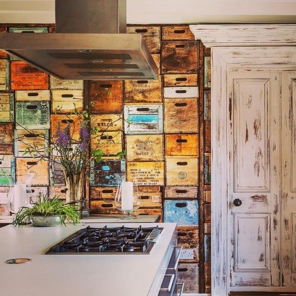 Check out this unusual kitchen design with crate box wallpaper. Love it! #KitchenDecor #KitchenDesign #HomeDecorIdeas @istandarddesign